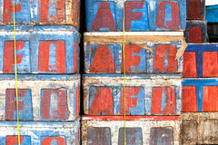 Colored boxes at marketplace. Brightly colored boxes stacked at fish market indonesia Royalty Free Stock Images