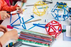 Colored boxes with paper strips, inventions and creativity for c. Hildren. educational activities for schools and children kid stock photo