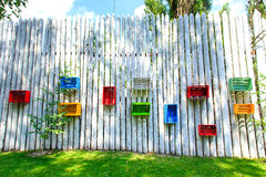 Colored boxes on a wooden fence Stock Photography