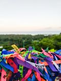 Colored Brazilian Ribbons with trees and sea in background stock photos