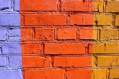 Colored brick wall in different colors Stock Photos