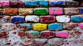 Colored Brick Wall. Texture with many live colors Stock Images
