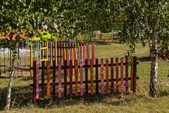 Colored and bright children`s fences. Children`s fence of bright colored dostochk, paired together in the whole on the playground Stock Image