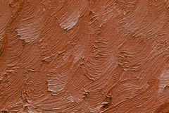 Colored brushstrokes of brown oil paint on canvas Royalty Free Stock Photo