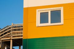 Colored buildings and structures in the territory of a large factory. The production yellow green white building Territory of the plant Royalty Free Stock Images
