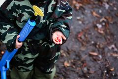 Colored bullets lie on the palm of a child stock photos