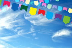 Colored bunting on a beautiful sky Stock Photo