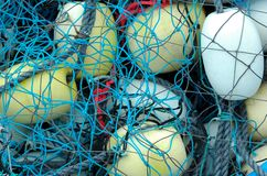 Colored Buoys. Colored wooden buoys in a net taken Peggy's Cove,NovaScotia,Canada Stock Photo
