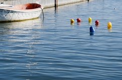 Colored buoys floating on the sea surface in the port Royalty Free Stock Photography