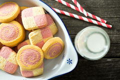 Colored butter biscuits with milk Royalty Free Stock Image