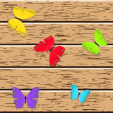 Colored butterflies. On wooden boards royalty free illustration