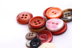 Colored buttons. Colored sewing buttons on a white background Stock Photography
