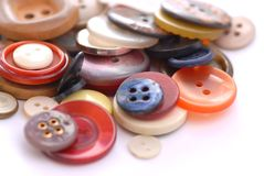 Colored buttons. Colored sewing buttons on a white background Stock Images