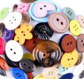 Colored buttons. Group of different colored buttons on white background Royalty Free Stock Photo