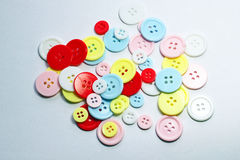 Colored buttons in a pile.. Royalty Free Stock Images