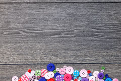 Colored buttons wooden board, Colorful buttons, on old wooden Royalty Free Stock Images