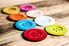 Colored buttons on wooden board, Colorful buttons, on old wooden Stock Photography