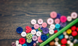 Colored buttons on wooden board Royalty Free Stock Images