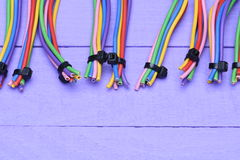 Colored cables on wooden background Stock Photography