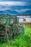Colored cage for lobster on shore in Scotland Stock Photo