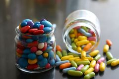 Colored candies in jars royalty free stock image