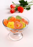 Colored candies with red hearts in glass bowl Royalty Free Stock Image
