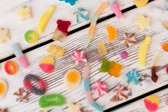 Colored candies scattered on white background. royalty free stock image
