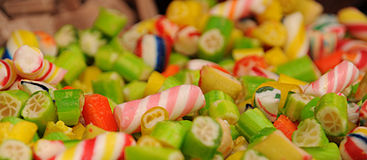 Colored candies on a stand in the city market II Stock Images