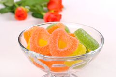 Colored candies with two red hearts in glass bowl Royalty Free Stock Photo
