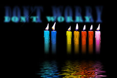 Colored candles be happy flooding water Royalty Free Stock Photography