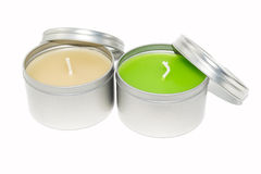 The colored candles with cover on white background. Royalty Free Stock Images