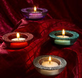 Colored candles. Festive candles in glitter holders royalty free stock photography