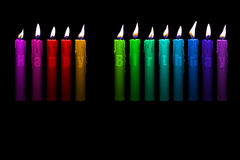 Colored candles happy birthday. Colored candles with happy birthday letters inside isolated on black background stock illustration