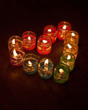 Colored candles in a heartshape Stock Photos