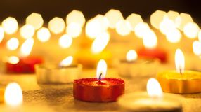 Colored candles lighted Royalty Free Stock Image