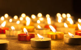 Colored candles lighted Royalty Free Stock Images