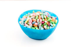 Colored candy in blue bowl Royalty Free Stock Image