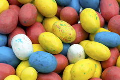 Colored candy Easter eggs lay in a basket. Royalty Free Stock Photo