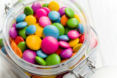 Colored candy in glass jar Stock Images