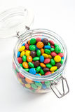 Colored candy in a glass jar. Colorful  candies  in glass jar, on white Stock Photos