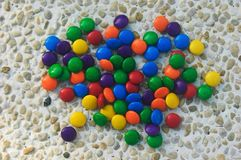 Colored candy. A lot of small bright colored candies Stock Images