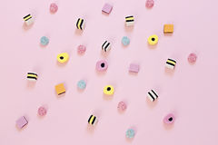 Colored candy scattered on the pink background. Jelly colored candy scattered on the pink background, abstract background concept Royalty Free Stock Images