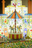 Colored candy village house, carousel. Toy candy royalty free stock image