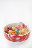 Colored candys in the bowl on the white background Stock Photos