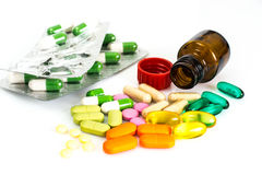 Colored capsules, pills and medical glass bottle Stock Photo