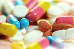 Colored capsules and tablets. Close up. Royalty Free Stock Photo
