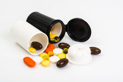 Colored Capsules, tablets and pills in a plastic jar Royalty Free Stock Photography