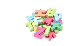 Colored card with letters of alphabet -multicolored plastic letters