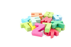 Colored card with letters of alphabet -multicolored plastic lett Royalty Free Stock Photo