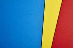 Colored cardboards background in blue yellow red tone. Copy space. Horizontal royalty free stock photography